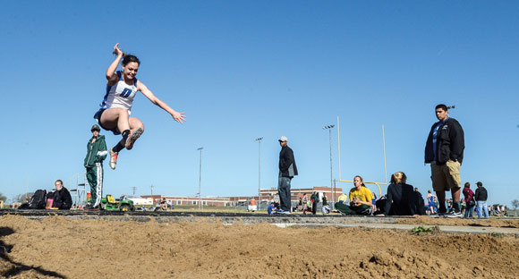 FLYING TO DISTRICT - Brianna Compton will look to repeat as district champ in the triple jump when district track meets around the area begin next week. Messenger photo by Joe Duty