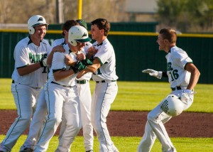 GOOD TIMES - The Panthers congratulate Colton Meadows after he delivered the game winning hit against Millsap Monday. Paradise used a seventh inning rally to win their fourth straight district game, 7-6. Messenger photo by Jimmy Alford