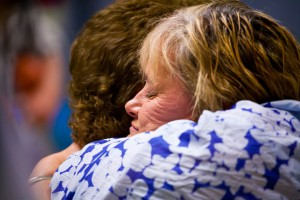 "GRATEFUL EMBRACE - Lori Carver hugs the neck of Wendy Vann, thanking her for her daughter's organ donation that enhanced the life of her 3-year-old grandson. ""Ashlie's the hero,"" Vann said. ""She would help anyone however she could."" Messenger photo by Jimmy Alford"