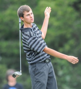 HANG ON - Jansen Alker watches his ball after he lets go of his club on the tee box. He shot a 77 in the second round. Messenger photo by Joe Duty