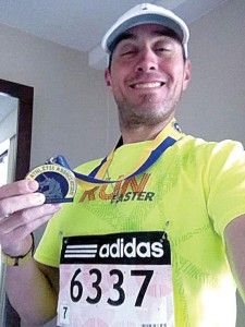 MOMENTS BEFORE - Prior to Boston Marathon bombing Thomas Aaberg snaps photo with medal in hotel room. Submitted photo