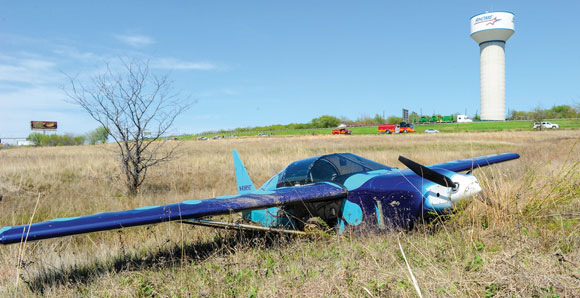 PLANE AS MUD - After making an emergency landing in a field, pilot James Vroom decided to attempt a takeoff. Mud ruined those plans. Vroom was not injured. Messenger photo by Joe Duty