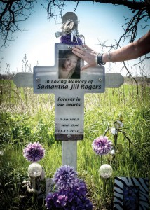 ROADSIDE MEMORIAL - A roadside memorial cross holds the photograph of Samantha Rogers. The 17-year-old and her best friend, Delaney Mancil, 15, both from Alvord, were killed in an accident Nov. 11, 2010, on U.S. 380 between Denton and the Wise County line. Messenger photo by Joe Duty
