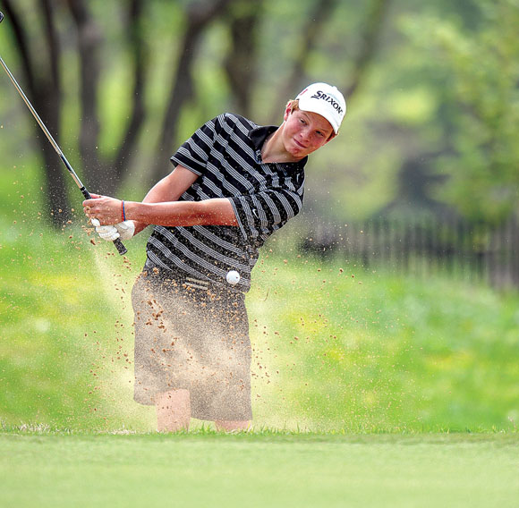 SAND SAVE - Drew Jones blasts out of a bunker during the regional tournament Tuesday at Tanglewood. Messenger photo by Joe Duty