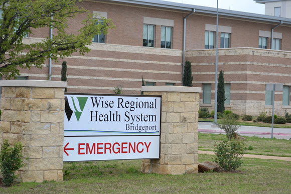 SIGNS OF CHANGE - Signs at the former North Texas Community Hospital in Bridgeport bear the facility's new name: Wise Regional Health System Bridgeport. Messenger photo by Bob Buckel