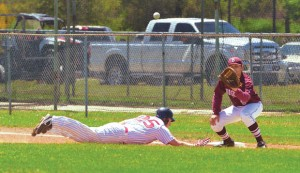 SLIDING BACK - Bridgeport's Damian Delgado awaits the ball as Gainesville's Dillon Schroeder dives back to first. The Bulls took down the Leopards, 7-0. Messenger photo by Clay Corbett