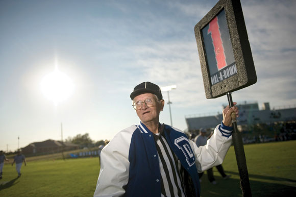 STANDING TALL - Coy O'Neal of Decatur awaits the start of an Eagle football game in 2008. This weekend the longtime sideline official and DHS graduate will celebrate his 80th birthday and 65th season pulling the chains. Messenger photo by Joe Duty