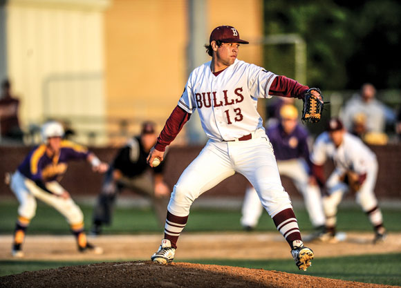 TOP SPOT - Bridgeport's Omar Martinez gets ready to deliver a pitch during the Bulls 6-4 win over Sanger Thursday. The win gives Bridgeport the top seed in the playoffs out of District 9-3A. Messenger photo by Joe Duty