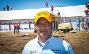 VISION BECOMES REALITY - The Rock Church in Justin Pastor Shane LeJeune helped lead hundreds of volunteers last Friday to build the church's first permanent home all in one day. Messenger photo by Joe Duty