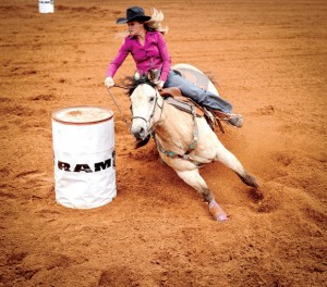 BARREL AHEAD - Barrel racer Abby Hurst cuts quickly through the red dirt Thursday morning in the Bridgeport Riding Club Arena. Messenger photo by Joe Duty