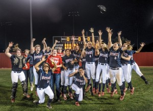 BI-DISTRICT CHAMPS - The Northwest Lady Texans celebrate after their 5-1 opening round playoff win against Weatherford Friday. Messenger photo by Joe Duty