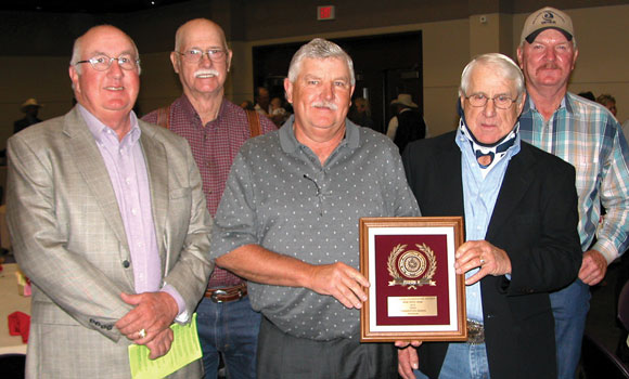 BOARD HONORED - The Wise Soil and Water Conservation District was named the Outstanding Conservation District at the Area V Conservation Awards Banquet Tuesday in Stephenville. Accepting the award was the district's board of directors, including (from left) Paul Wood, Merlin Remmele, Cody Gillispie, Wayne Long and Bill Fennell. Messenger photo by Denny Deady