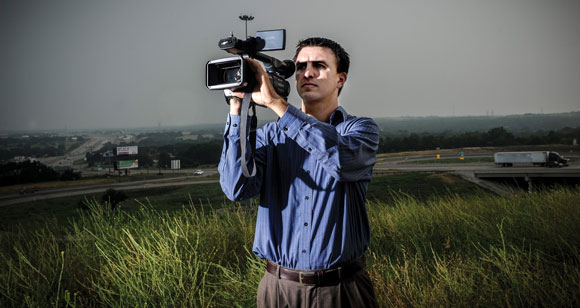 COMBING THE SKIES - Extreme storm chaser Jason McLaughlin, 31, has spent 13 years chasing and documenting tornadoes. He uses social media to provide warnings and updates on storms and tornadoes while out on location. Messenger photo by Joe Duty