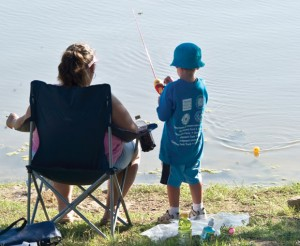 FISHING BUDDIES -A little fisherman hopes to land a big one at a past Adopt-A-Fisherman Day on Lake Bridgeport. This Saturday will mark the 22nd year for the event. Messenger photo by Joe Duty