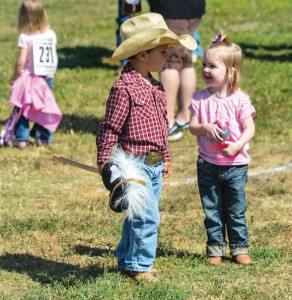 FRIENDLY COMPETITION - Cayne Blessing, 3, and Blayne Pearson, 2, visit in between Butterfield Stage Days Stick Horse rodeo events. Messenger photo by Joe Duty