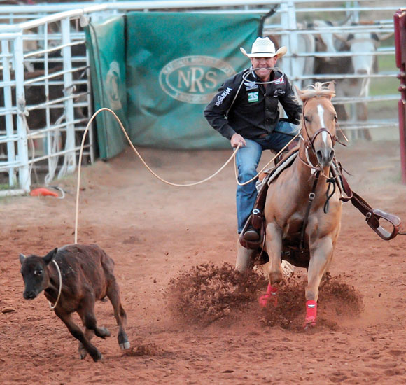 LIGHT IT UP - Decatur cowboy Trevor Brazile ropes a calf Saturday night en route to claiming the all around cowboy title for the Butterfield Stage Days PRCA Rodeo. Brazile competed in tie-down, steer roping and team roping during the three-day rodeo at Bridgeport Riding Club Arena. Messenger photo by Joe Duty