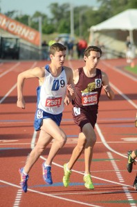 LONG DAY - Decatur's Taylor Clayton rounds the corner in the 3200 meter Saturday. He came back later that night to compete in the 1600 meter. Messenger photo by Mack Thweatt