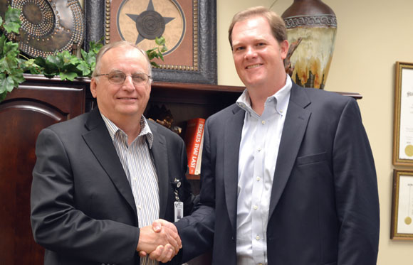 NEW POSITION - Wise Regional Health System CEO Steve Summers (left) welcomes Decatur attorney Jason Wren on board as the hospital system's first general counsel. As the in-house attorney, Wren will spend most of his time on contracts and risk management. Messenger photo by Bob Buckel
