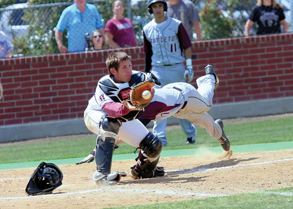 PLAY AT THE PLATE - Princeton's Grant Gilbert dives for home as he tries to beat the throw to the plate, as Bridgeport catcher Dillon Waldrep comes up with the catch. Photo by Victor Tapia