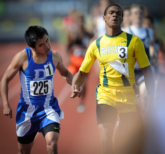 PULLING AHEAD - Decatur's Brandon Rivera raced hard down the stretch for a third-place finish in the 800. His time was good enough for him to advance to the state meet. Messenger photo by Joe Duty