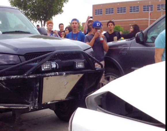 REAR-ENDED - Students gather around and photograph the scene of an apparent parking lot rage incident Thursday at Decatur High School. Submitted photo