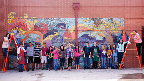 ON THE WALL - On Friday, students in Bridgeport's Art II class and teacher Sherri Jones pose in front of a nearly-completed mosaic that is the product of several months of hard work. Messenger photo by Jimmy Alford