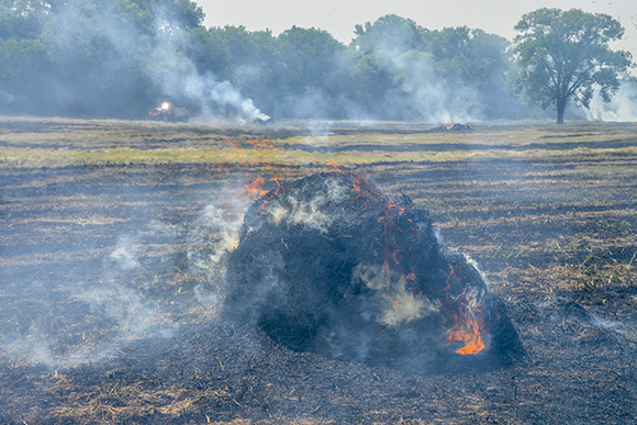 GREAT BALES OF FIRE - About five hay bales, a baler and 25 acres burned in a field fire east of Bridgeport Saturday morning. Decatur and Paradise units assisted Bridgeport in extinguishing the blaze, which was mopped up by 3 p.m.