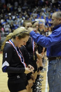 Superintendent Rod Townsend presents the Decatur Lady Eagles with their medals after winning the Class 3A state volleyball championship Saturday. Messenger photo by Joe Duty