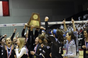 The Decatur Lady Eagles celebrate after winning their first-ever state volleyball title Saturday afternoon. Messenger photo by Joe Duty