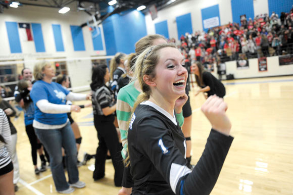Decatur volleyball player Stormi Leonard celebrates a playoff win. Messenger photo by Joe Duty