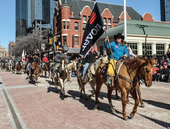 ON HORSEBACK - Devon employees took to the streets of Fort Worth Saturday to participate in the stock show parade. The Fort Worth Stock Show and Rodeo runs through Feb. 8, and Wise County folks will be participating as volunteers and competitors. Messenger photo by Joe Duty