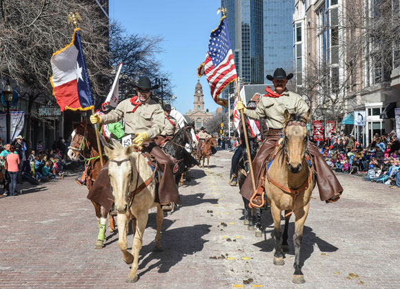 RIDING FOR WISE - Wise County Sheriff's Posse President Russell Stephens (left) and Cody Burgett lead other Posse members in the Fort Worth Stock Show and Rodeo (FWSSR) All Western Parade Saturday morning in downtown Fort Worth. More than 2,300 horses participated in the legendary event, which is the unofficial kickoff to the FWSSR. Messenger photo by Joe Duty