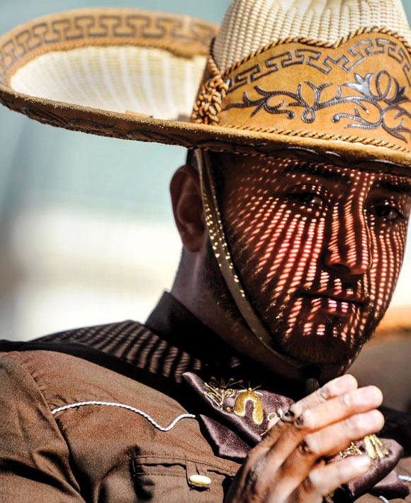 UNDER THE SOMBRERO - The sun casts intricate shadows across the face of a charro during Saturday's stock show parade in Fort Worth. Messenger photo by Joe Duty