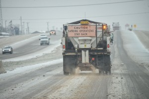Trucks dump sand on highways Sunday to counter effects of slick roads caused by winter storm. Photo by Joe Duty.