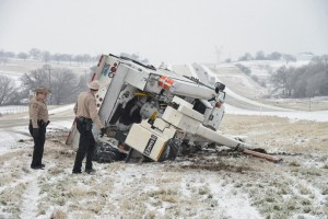 A one-ton truck hauling heavy equipment on U.S. 287 just north of Decatur was one of dozens of accidents due to the snow and sleet storm Sunday. Photo by Joe Duty.