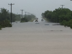 Only the tops of two cars are visible above the flood waters on FM 1810 east of Chico. Messenger photo by Joe Duty