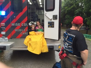 Children rescued from a home in Chico wait in the back on an ambulance. Messenger photo by Joe Duty