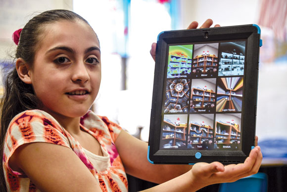 A NEW PERSPECTIVE - Fifth-grade student Jazzmin Andrade shows off her new iPad at last week's distribution at Rann Elementary. Messenger photo by Joe Duty