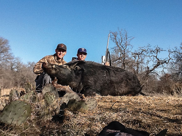 PRIZE PIG - Cason Caraway and Andrew Gage show off a 399-pound feral hog killed in Cundiff during the third annual Wise County Hog Hunt where pairs of hunters gunned for the heaviest hog in the area. Unofficial results have Caraway and Gage winning the contest. Messenger photo by Joe Duty