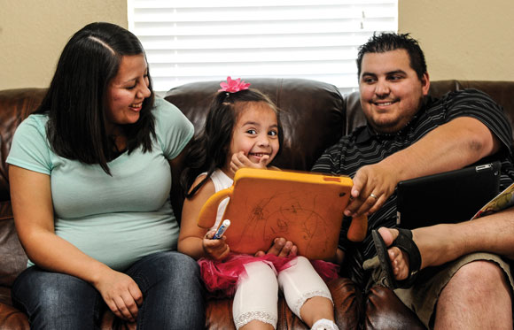 A NEW START - Elda Flores, is expecting a baby boy in June, said family became her focus when she couldn't explore a career in nursing. Messenger photo by Joe Duty