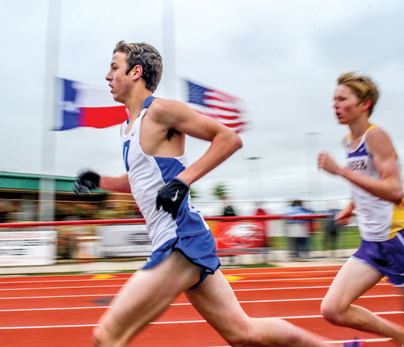 KEEPING THE PACE - Decatur's Taylor Clayton went on to a second-place finish in the 3200 at the area meet in Argyle. He also took second in the 1600. Messenger photo by Joe Duty