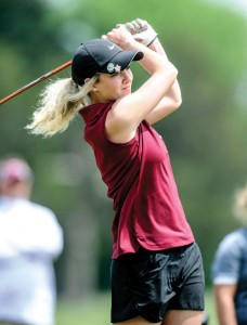 WINDY DAY - Tiffany Hawkins and the rest of the Sissies battled cool and windy conditions at the regional golf tournament. Messenger photo by Joe Duty